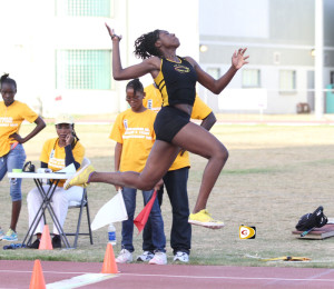 Kala Penn sails through the air to complete a Long and Triple Jump double victory