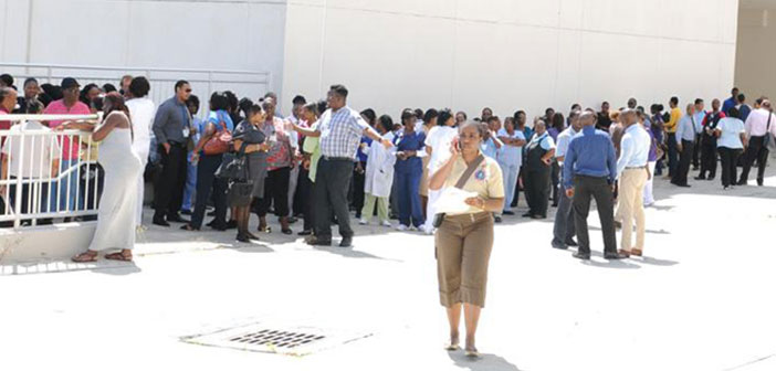 The tsunami simulation exercise drew participation from several Government departments, statutory bodies and companies in the private sector. Pictured here are administrative staff, out-patients and visitors who evacuated the Peebles Hospital. DDM's Deputy Director, Ms. Evangeline Inniss is pictured in the foreground reporting  to the NEOC on the status of the evacuation. Photo Credit: Department of Information and Public Relations (GIS).