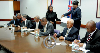 Premier and Minister of Finance, Dr. the Honourable D. Orlando Smith, OBE and Minister for Communications and Works, Honourable Mark Vanterpool are pictured here with officials from the BVI Ports Authority, along with representatives from the IDL/Meridian Construction following the contract signing ceremony on April 22 to begin the works for the cruise pier expansion project. (Photo Credit: Ronnielle Fraser/GIS)