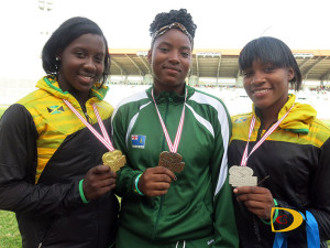 BVI's Tynelle Gumbs, center displays her U20 Girls Discus Throw medals with her Jamaican counterparts