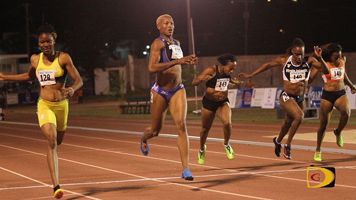 St. Vincent & the Grenadines' Kineke Alexander, left, Barbados' Jade Bailey, BVI's Tahesia Harrigan-Scott, USVI's Laverne Jones-Ferrette and BVI's Ashley Kelly in the 200m won by the USVI's Allison Peter, not pictured