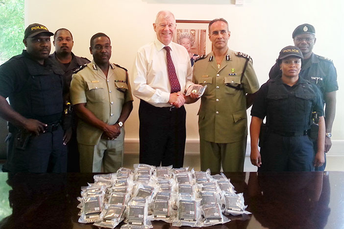 His Excellency the Governor Boyd McCleary turns over 250 trauma kits to the Commissioner of Police David Morris. Attending the presentation ceremony at the Governor's Office are Deputy Commissioner Alwin James, Force Armourer Inspector Ernest Gumbs and officers from the Tactical Team.