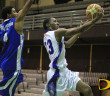 Legs' Jovaughn Cameron goes for two points as All Ah We's Jamal Serrant tries to block the shot
