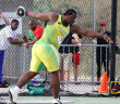 Eldred Henry competes in the Discus Throw where he had a best mark of 52.15m to finish fourth
