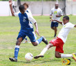 BVI's Marcus Lake, right and Laraza's Captain Grant Farrell attacking the ball