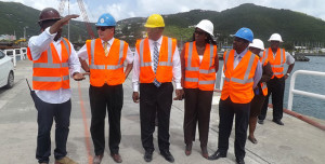 His Excellency the Governor, John S. Duncan, OBE and ministry staff at a safety briefing on Cruise Pier Development Project's construction site September 9. (Photo Credit: Sheriece Smith, GIS)