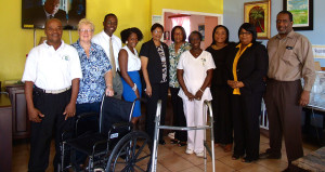 Manager of the Adina Donovan Home, Mrs. Jacqueline Donovan and staff standing alongside members of Rotary Club Rotary Club Sunrise of Road Town on September 15 after the adoption and donation of a wheelchair, walker and lifting device. (Photo Credit: Robert Wright/ADH)