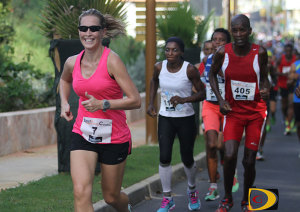 Katrina Crumpler leads a group of runners up an incline in the early stages of the NACAC Petit Bourg 10k in Guadeloupe