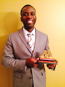 Keita Cline displays his award after being inducted into the University of Minnesota Hall of Fame