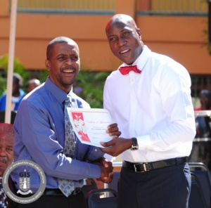 Minister of Education Hon. Myron Walwyn congratulating honouree Past Education Minister Hon. Andrew Fahie