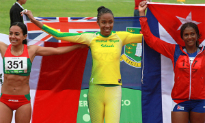 Chantel Malone stands at the top of the podium, flanked by a Cuban and a Mexican after claiming Long Jump gold. PHOTO CREDIT: Cleave M. Farrington