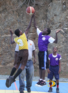 Francis Lettsomes' Devonte Walters, left and Willard Wheatley's Shakoy Cheltenham top play in Greenland last Wednesday in the Primary Schools Basketball League