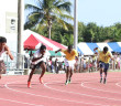 A Division 13+ Boys compete in the 200m