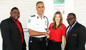 Managers of RVIPF's newest corporate partners Digicel BVI (L-R) Kevin Smith, Jayne Gray and Matthew Daly pose for a photo with Commissioner of Police David Morris following  Force Lecture and Commendation Luncheon.