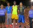 """Premier Dental chief executive Dr. Garfield Neita, left, with Ronique Todman, Kyron McMaster, Tarique """"Tweety"""" Moses--the first three athletes to run the 400m under 50 seconds on home soil--and Melissa Flaherty"""