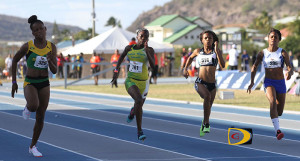 "L'Tisha ""Bella"" Fahie, 2nd left, runs 11.85 seconds in the U18 Girls 100m semifinals a time she matched in the final for a personal best. L-R: Shaeil English, Jamaica, Fahie, Nia Jack, U.S. Virgin Islands and Jessie Zali, Martiniqu. PHOTO CREDIT: Dean ""The Sportsman"" Greenaway"