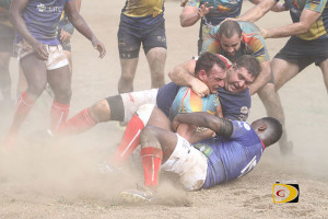 Andrew Seeckts, right gets help from Ade Haffner in taking down a Curacao player near the goal line as the BVI Men's Rugby team's defense prevented their opponent from scoring during a 19-0 rout for their first home victory and first shut out