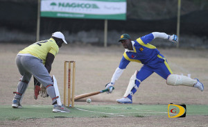 Under The Tree's Sylvester Mitchell gets run out during their friendly encounter with Vincy on Sunday