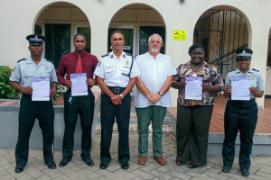 Four of the eight officers who received ASA Level 1 Certificates pose for a photo with Commissioner of Police David Morris and Instructor Brian Brinkley (centre)
