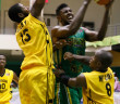 BVI's Leslee Smith goes to the hoop against Antigua and Barbuda's Kurt Looby, left and Lennox McCoy
