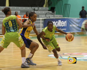 "Joi-Ann Thomas, left, tries to use her body to help captain Tamara ""Tammy"" Phillip get past Barbados'Ashley Daniel on Tuesday night. Phillip finished with 8 points and 11 rebounds after dropping in 28 against Guyana"