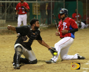 Safe: A Dominicans player as safe at home base against Power Outage in a game they won, 16-13