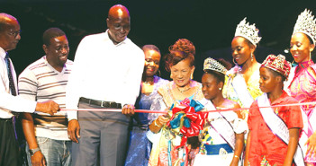 Premier Smith and Education & Culture Minister Hon. Walwyn assist Patsy Lake as she cuts the inaugural ribbon at the 2015 Festival Village named in her honour. [Photo Dean Greenaway]