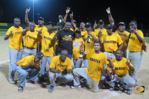 Pirates players are joined by sponsor Hon. Marlon Penn in celebrating their 2015 BVI Softball Association best of seven Championships Series crown. The Pirates beat the Reds 14-7 on Sunday night to win the series 4-2.