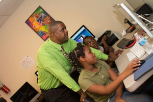 Hon. Andrew Fahie  observes students learning computer skills