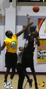 The Starz's Khoy August, right and Ahdan Doward of Real Tool, tip off Sunday night's first game in the Hon. Julian Fraser Save The Seed League.