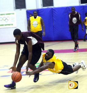 Real Tool and Starz's players hustle for the ball before half time of Sunday's game.