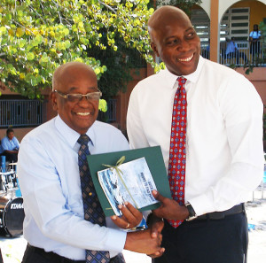 Dr. Charles Wheatley receives plaque from Minister for Education & Culture Hon. Myron Walwyn