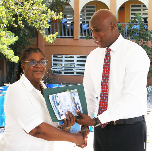 Dr. Patricia Turnbull receives certificate from Minister for Education & Culture Hon. Myron Walwyn