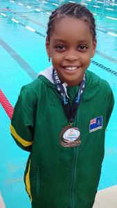 Eight year old Khadija Sampson wins OECS Swimming Championships 100m Freestyle bronze. Photo: Elsworth Phillip