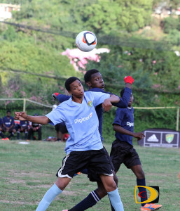 Elmore Stoutt and Bregado Flax players go for a header during Thursday's exhibition match at Greenland, which brought the curtains down on the High School Football season