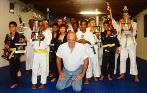Judo Instructor Mark Hooper proudly poses with his students