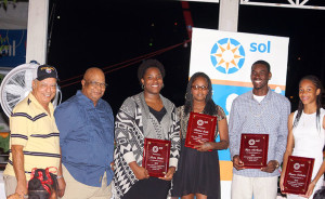 Former Presidents Johnny Hassan, left and John Lewis, with 2015 BVI Athletes of The Year Presented by Sol, Trevia Gumbs, Jr. Female AOY; Janella Thomas for her son Malaki Smith, Youth Male, AOY; Kyron McMaster, Jr. Male AOY and Beyonce DeFreitas, Youth AOY. Photo Credit. Cleave M. Farrington.