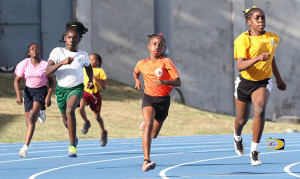oyce Samuel's Kieanjah Roberts, right, en route to an U13 Girls 200m victory over First Impression's Amia Todman who was third and Ivan Dawson's Ronnayah Phillip who placed second.
