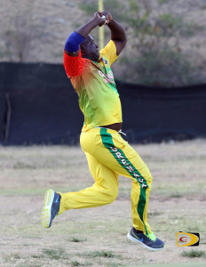 Grenada's fast bowler Emmanuel Charles at his pinnacle, preparing to bowl to Vincy's Monty Butler.