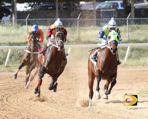 Honors, right, leading Bellamy Chief and Exploring off the first turn in the 7 Furlongs feature race