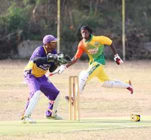 Grenada's Dave Johnson avoids being run out against Royal Knights before being caught by Murray Ollivere for 15