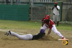 Caught in a run down, a Mobsters batter is tagged out retreating to first base