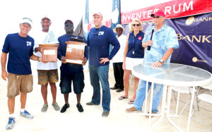 Intrepid takes 1st place in the VP Bank Tortola Sloop Spring Challenge and the perpetual winners trophy presented by VP Bank President, Sjoerd Koster with Judy Petz, Regatta Director and Professor Geoffrey Brooks. [Photo courtesy of   Todd VanSickle ©]