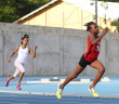 Ariyah Smith floats around the curve to win the U13 Girls 200m on Saturday