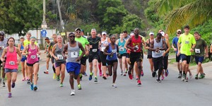 Runners take off on the second half of the Virgin Gorda Half Marathon course during Saturday's Dive BVI 10K series finale, which was a tune up for the event. PHOTO: Todd VanSickle