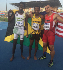 BVI's Kyron McMaster, left, with Jamaica's Jaheel Hyde and the USA's Taylor McLaughlin, after the 400m Hurdles PHOTO; Dag Samuels