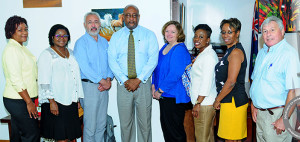 Minister for Health and Social Development, Honourable Ronnie W. Skelton is pictured meeting with the evaluation team from the Pan American Health Organisation (PAHO) and the World Health Organisation (WHO) on July 7. The team is in the Territory to verify that the BVI has successfully met the Elimination of Mother to Child Transmission of HIV and Syphilis (EMTCT) criteria. Discussions were held with Minister Skelton, Permanent Secretary for the Ministry of Health and Social Development, Mrs. Petrona Davies; Chief Nursing Officer and Family Health Coordinator, Mrs. Jacinth Hannibal; and former Family Health Coordinator, Ms. Noelene Levons. The six member evaluation team included Mary Kamb and Ron Ballard from the Global Validation Committee; Miriam Chipimo and Yolanda Simon for Human Rights;  and Freddy Perez and Sandra Jones from PAHO. (Photo Credit: Ronnielle Frazer/GIS)