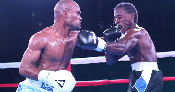 """Julan """"Iron Fist"""" Brown, left, uses a left hook against Miguel """"Iron Dog"""" Rey to score valuable points during his TKO victory"""