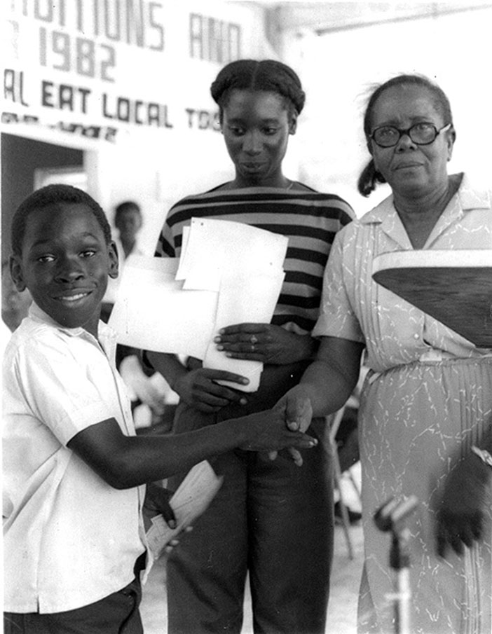 1982: Tortola, East End student receiving congratulations
