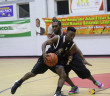 LaShaquah Fahie of the Starz drives past Next's Kelvis Phillips